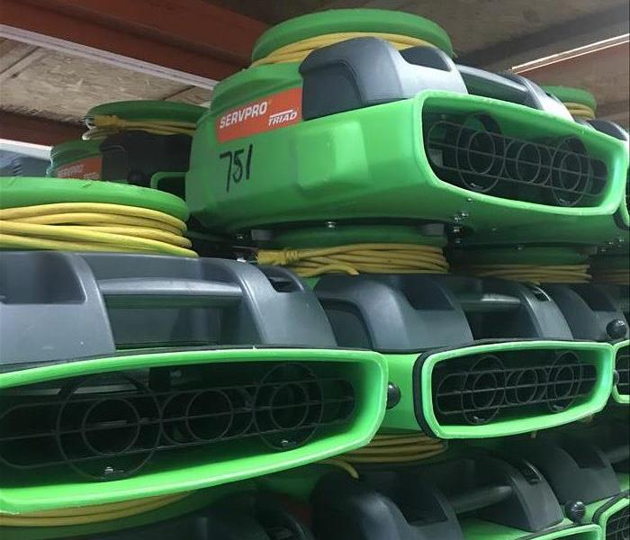 Close up of green SERVPRO air movers